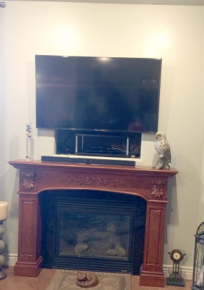 Existing corner fireplace with hole behind TV