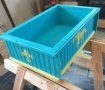 Box with clear coat