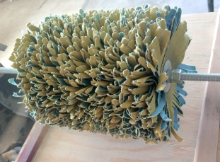 sandpaper stacked on rod